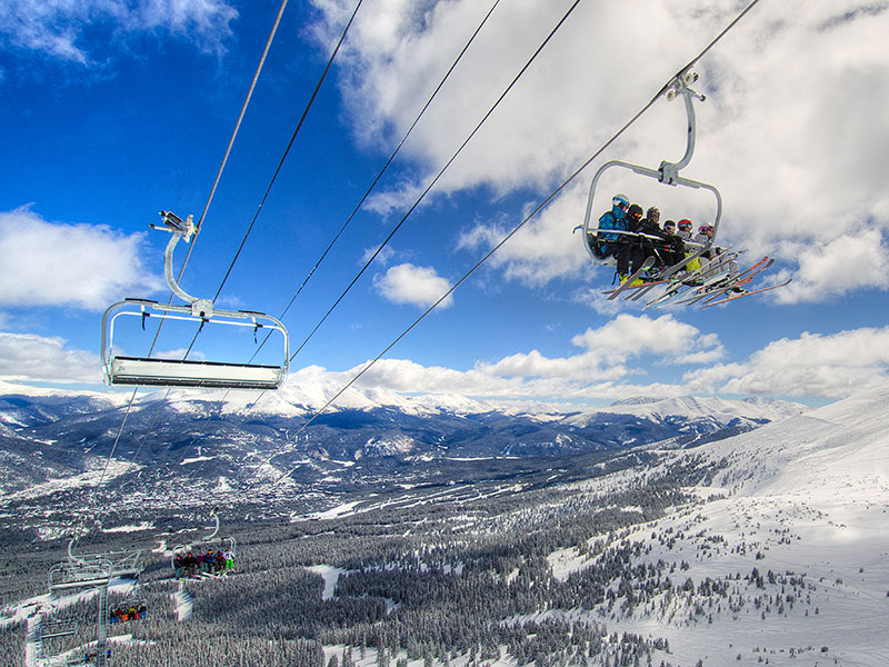 People riding a chairlift at Breckenridge