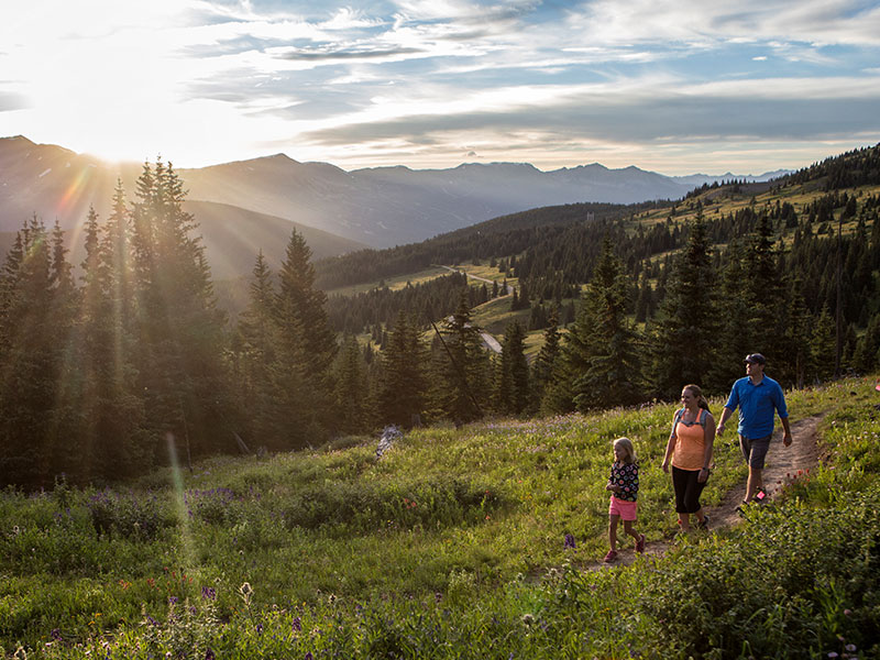 family hiking at sunset at black powder pass