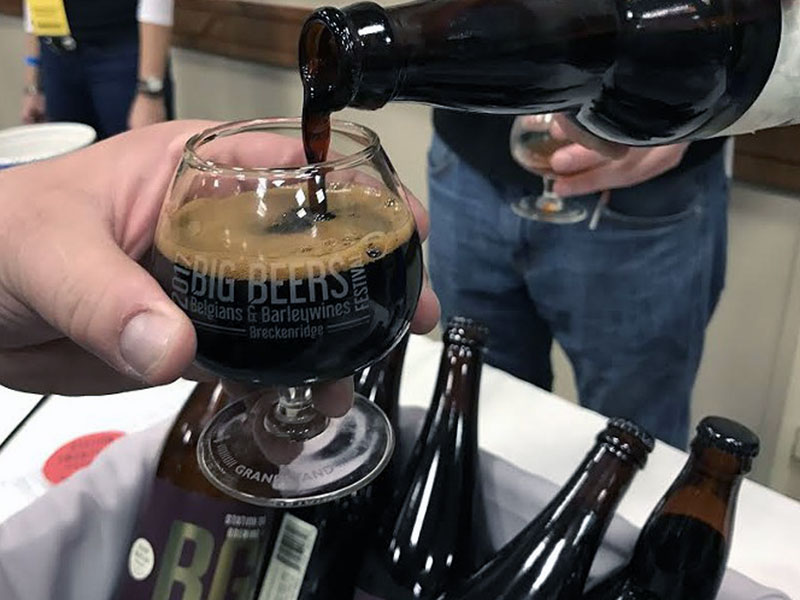 Dark beer being poured into glass