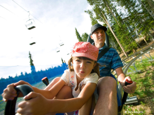 dad and daughter on the alpine slide